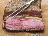 Roast beef with meat fork