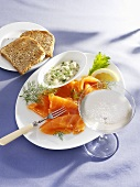 Smopked salmon with a lemon and dill sauce, toast and champagne