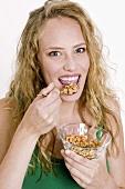 Woman eating crunchy muesli