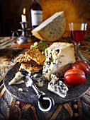 Blue cheese with sesame crackers, wine