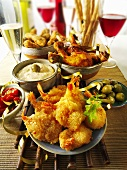 Party buffet with prawns, chicken, olives and a dip