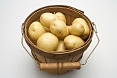 Potatoes in woodchip basket