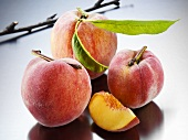 Yellow Florentine peaches with leaves