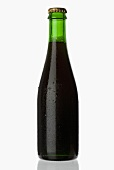 A chilled bottle of stout (dark beer)