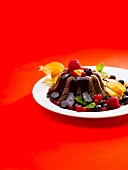 Chocolate pudding with fruit and chocolate sauce