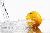 Orange with splashing water