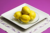Small Pile of Lemons on a Glass Dish