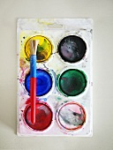 Watercolours with paintbrush