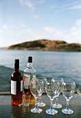 Drinks and empty glasses on tray by sea