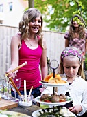 Girls at smorgasbord in garden (Sweden)