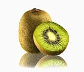 Whole kiwi fruit and half a kiwi fruit with reflection