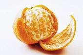 Half-peeled mandarin orange