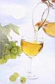 Pouring grape juice from glass jug into glass