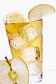Apple spritzer with ice cubes in glass