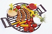 Grilled sausages with vegetables and dips