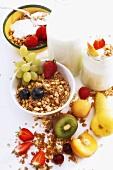 Muesli ingredients (cereals, milk, yoghurt, fruit)