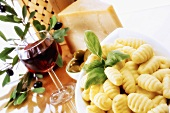 Fresh gnocchi, Parmesan, olives and red wine