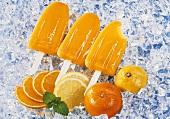 Three mandarin orange and lemon ice lollies