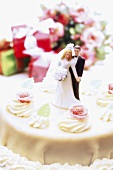 Wedding cake with bride and groom topper