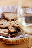 Bread basket and glass of white wine
