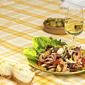 Seafood salad and a glass of white wine
