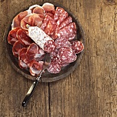 Sliced salami and ham on plate, elevated view