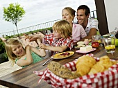 Family having breakfast on terrace