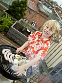 Boy preparing barbecue