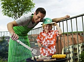 Father and son preparing barbecue