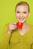 Young woman with a cup of espresso