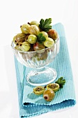 Gooseberries in dessert glass on table mat