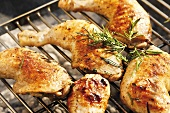 Chicken legs with rosemary on barbecue