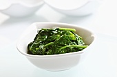 Blanched spinach in ceramic bowl