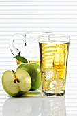 Apple juice in glass and glass jug