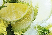 Limes in block of ice (close-up)