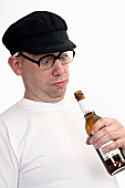 Man holding beer bottle