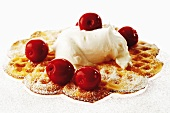 Waffle with cream and cherries, close-up