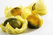 Several ugli fruits in paper