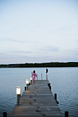 Girl on a lakeside landing stage