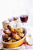 Chicken legs with glass of red wine