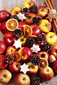Apples, nuts, christmas cookies and cinnamon sticks