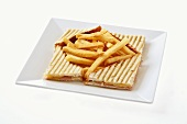Cheese and ham toastie with chips