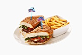 Steak sandwich with dish of chips