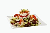 Tower of crab salad, tomatoes and blue cheese