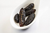 Dried tonka beans on spoon