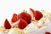 Strawberry cream cake with sugar confetti (detail)