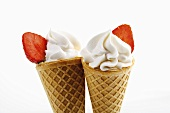 Soft ice cream with strawberries in waffle cone