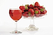 Strawberries and glass of rosé wine