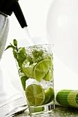 Adding soda water to Mojito