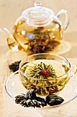 Tea with tea flower in glass cup